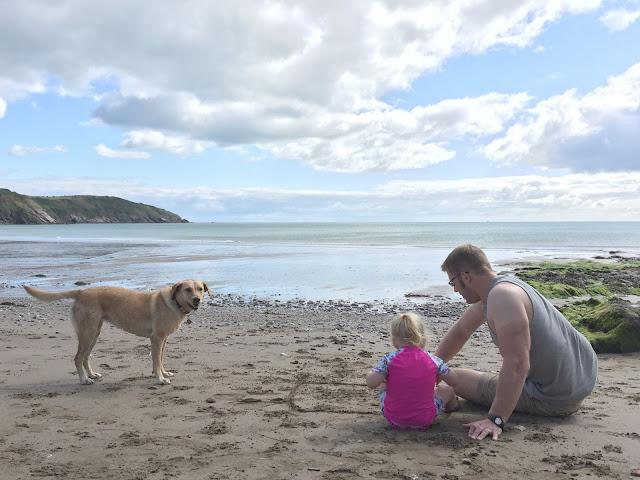 The Tin Box Family sat on a beach