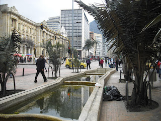A homeless man finds a strange place to kip on a busy afternoon in downtown Bogotá