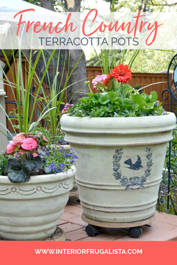 How to transform large terracotta flower pots with lovely weathered French Country style with a wash of Versailles chalk paint and French graphics. #frenchcountrystyle #outdoorflowerpotideas #diyagedterracottapots