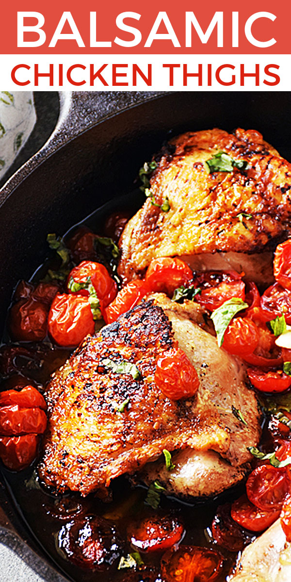 Balsamic Chicken Thighs with Tomatoes in a cast iron skillet ready to serve and enjoy