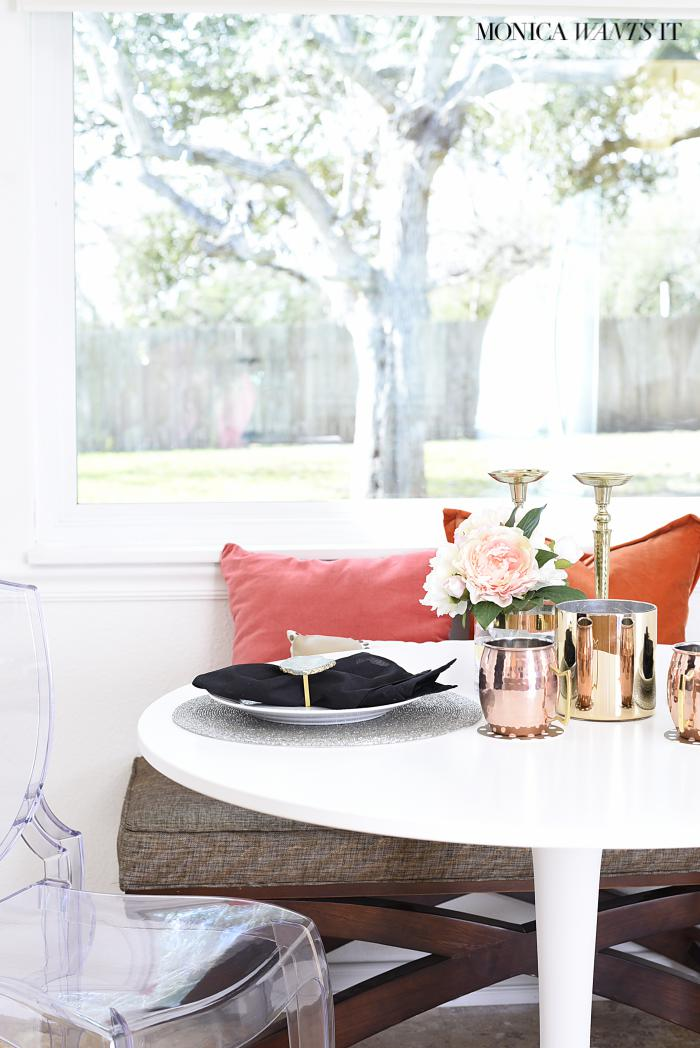 This is a beautifully made over breakfast nook. It's chic, sophisticated and feminine.