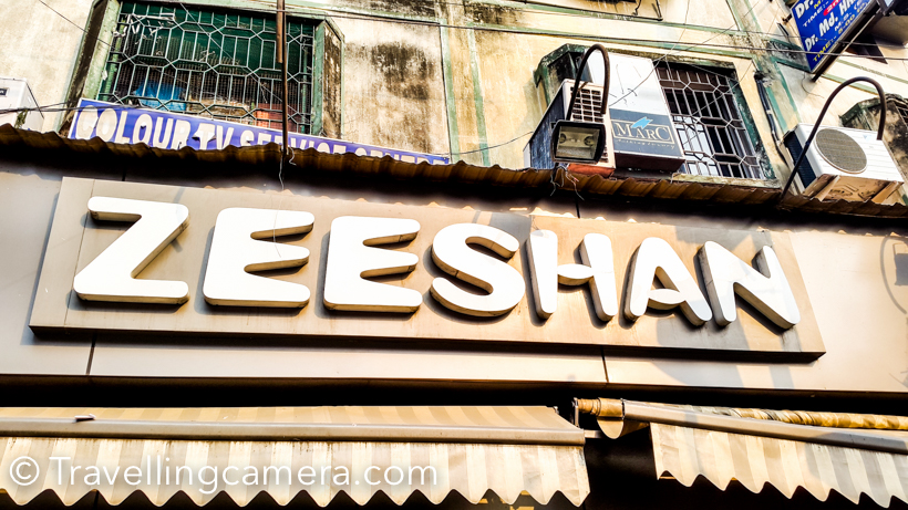 When in Kolkata, it's must to try out various food options around the city and whatever we tried in 4 days, Zeeshan was the best place and this post shares more about the place and why we loved it so much.One of our friends took us to Zeeshan, which is located near Park Circus area. It's a two storey restaurant in a busy market, which serves brilliant biryanis and various non-veg delicacies.We ordered 3 Mutton Biryanis. Each portion is enough for one person. It's a place full of Biryani with one piece of mutton, egg and potato each. This is first time, I saw full egg and Potato in mutton biryani. I really loved the biryanis. out of 3 plates, I had 1.5 and other 1.5 was shared by Vibha & Roy.Unlike North India, you don't get raita with Biryani. Apart from Biryani, we ordered a mutton kosha and few kebabs. We had enough time to enjoy the food and that's very important when you visit a place like Zeeshan to enjoy food.The photograph above is showing pot of phirni stocked in refrigerator.  When we were full, Roy suggested us to try Phirni at Zeeshan and this was first time I realized that how phirni looks like.Our phirni pot looked like this within few minutes :) . It's served in earthen pot and the cover on the top is also an earthen pot.The top floor of Zeeshan has completely different decor than what you see on ground floor. It's air conditioned part of the restaurant and it seems that service tax is added only if you have meal on the upper part. If you have to get a parcel, people take it from the counter on ground floor.Above photograph shows the ground floor of Zeeshan and the counter on top right. We also got stuff packed, which was picked from this counter.All the preparations happening in the kitchen look awesome. It felt like I should come here again before we come back to Delhi, but we couldn't manage that.After our meal, we walked around the place and found this little pan shop.We highly recommend to visit Zeeshan if you are visiting Kolkata and love mutton Biryani. Zeeshan is the place for people who love no-veg food.