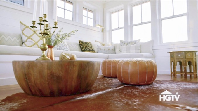 Moroccan leather poufs, drum coffee table, built-in sofa. Shop the Room! Sarah Richardson {Belvedere Rooftop Gallery}