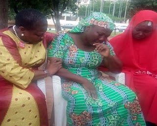 Former Minister of Education Oby Ezekwesili (left) and another member of the BBOG Movement consoling Esther Yakubu (middle), mother of Dorcas, the Chibok girl who spoke in the latest Boko Haram video at the #BBOG sit out in Abuja...yesterday.