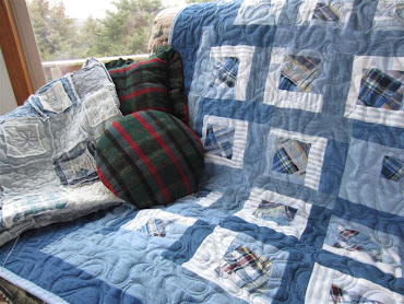 "I ""up cycled"" plaid shorts and denim dresses and shirts to create this quilt."