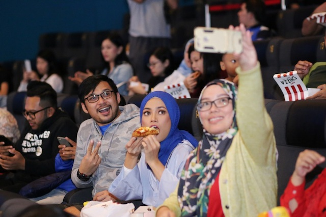 Chizza fans having a great time feasting before the movie