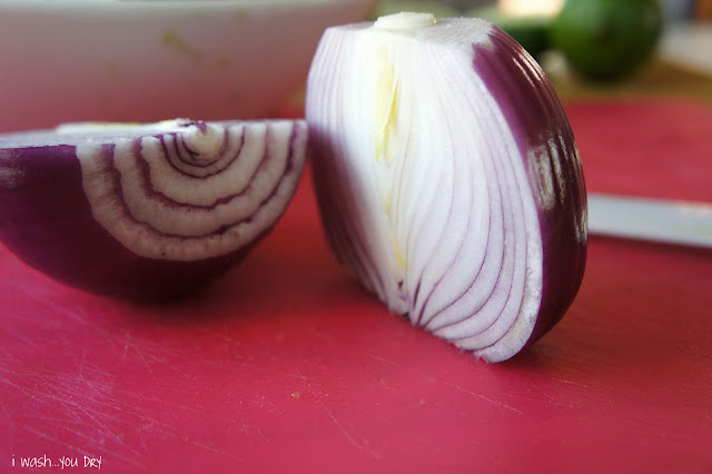 Two halves of an onion on a cutting board.