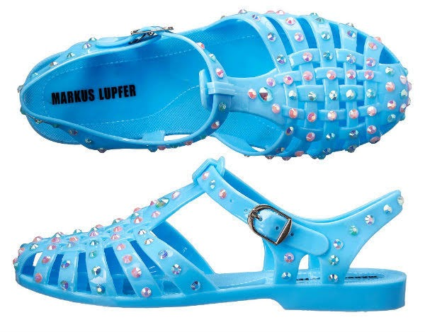 stock image of blue jelly Markus Lupfer shoes with small crystal studs on white background