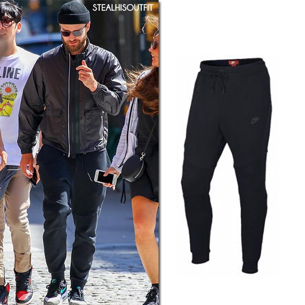 Justin Timberlake in black jacket and black joggers nike shop his outfit july 2017