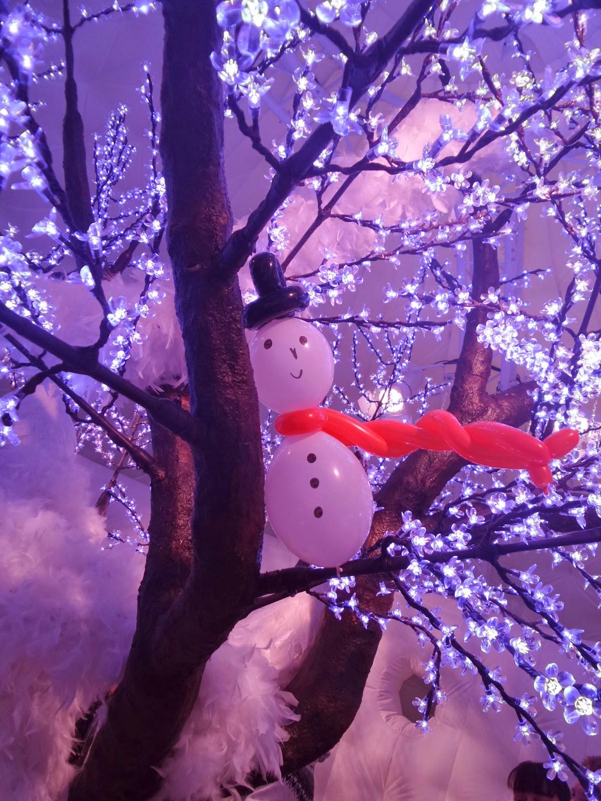 A Balloon Snowman in a tree
