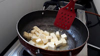 frying paneer in kadhai image