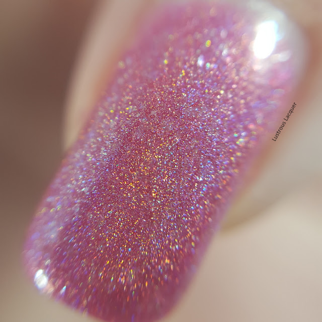 Medium-pink-linear-holographic-nail-polish-with-scattered-holographic-glass-flecks