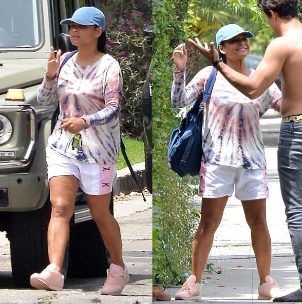 Christina Milan spotted hugging shirtless man in hot LA weather