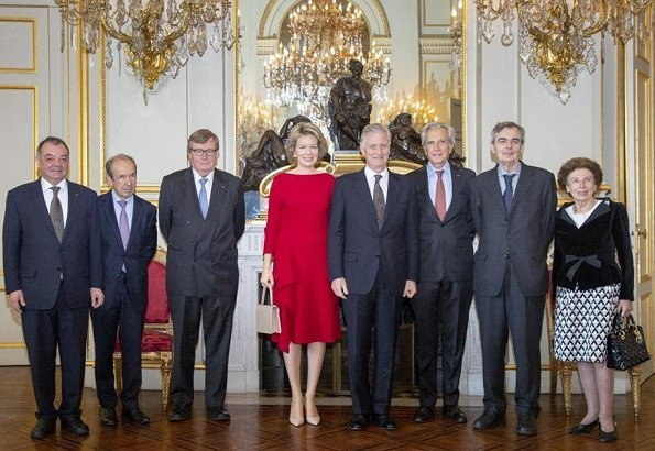 Queen Mathilde wore H&M Red Long Sleeve Ruffle Midi Dress. royal reception at the Royal Palace in Brussels. Edouard Vermeulen