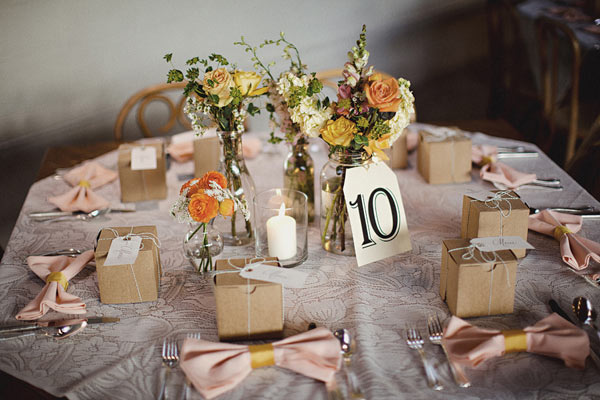 Tables at this October wedding in Marfa, Texas were set with garden roses, amber amaranthus, basil, and café au lait dahlias; each plate held a personalized menu calligraphed in plum ink.