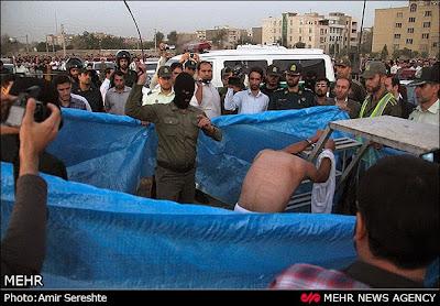 Karaj, Iran, 2014. A prisoner is flogged before being hanged in public.