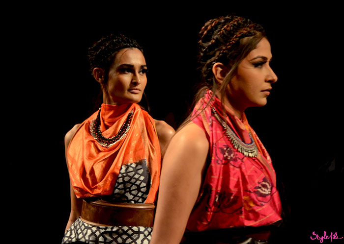 Braided coiled buns, bright colours and statement necklaces seen on models at the Doubt Is Out by Ajio at Lakme Fashion Week at The St. Regis Hotel in Mumbai
