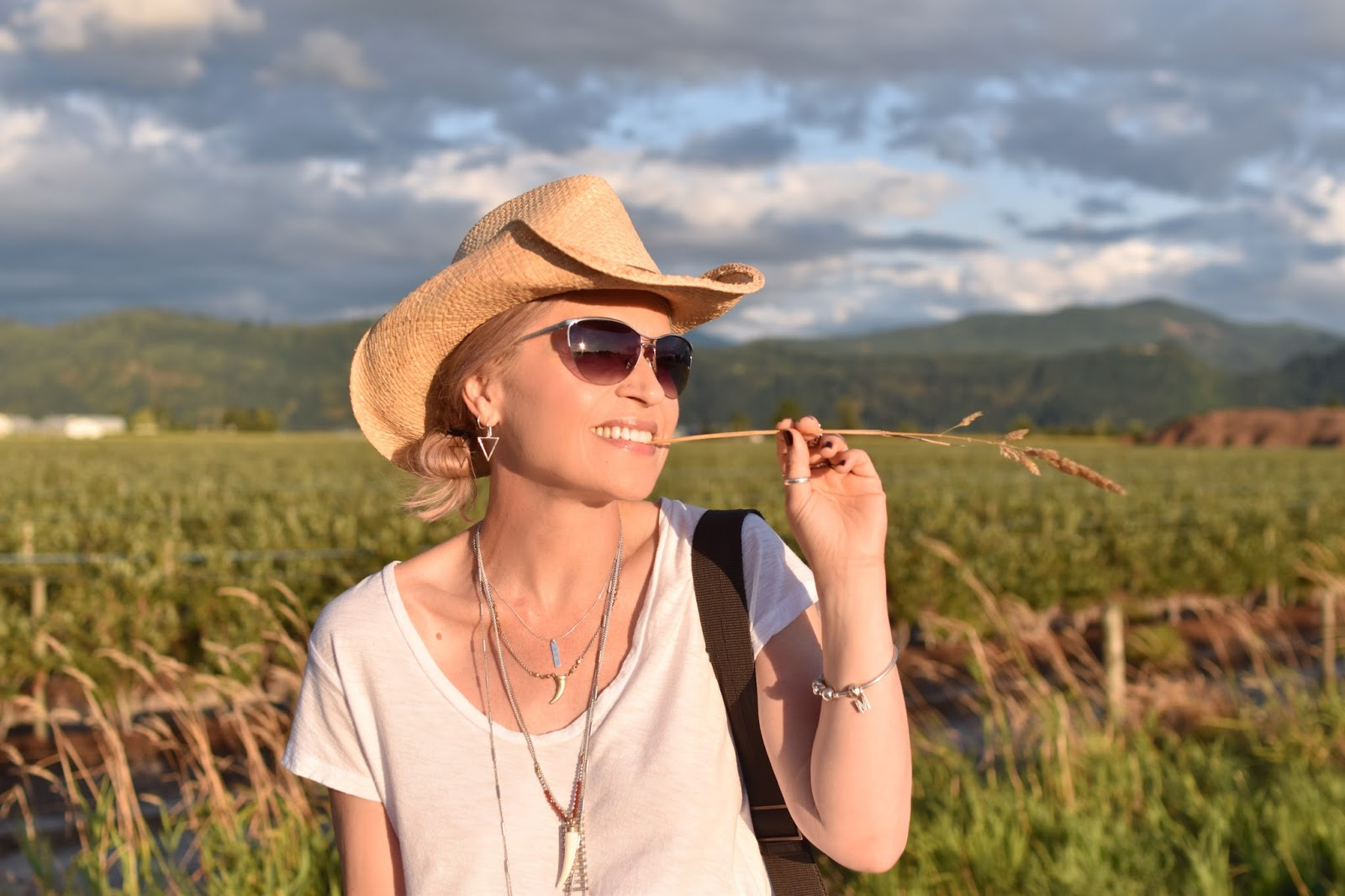 Monika Faulkner outfit inspiration - slouchy white tee, cowboy hat, wire-frame sunglasses