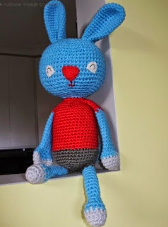 http://www.craftsy.com/pattern/crocheting/toy/odie-the-bunny---an-amigurumi-pattern/7721