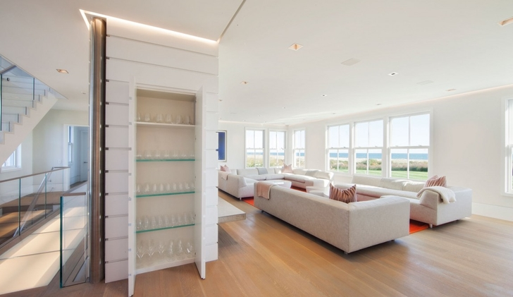 Open closet in the living room of Contemporary style home on the beach