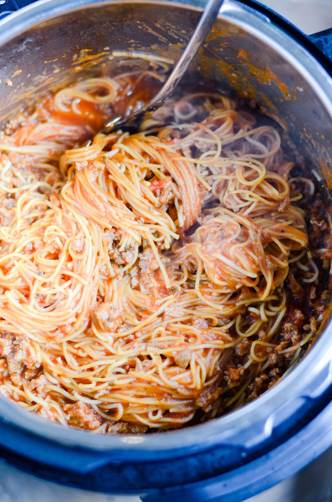 This instant pot spaghetti comes together quickly in one pot, from browning FROZEN ground meat to boiling the noodles. A great weeknight dinner recipe to keep in your back pocket!