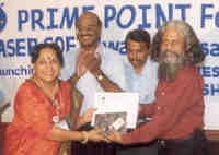 Prof Mamota Das receiving the 'Certificate of apprreciation'