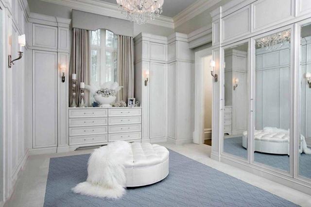 Glamorous white mirrored closet.