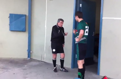 Aaron Eccleston argues with the referee before being sent off