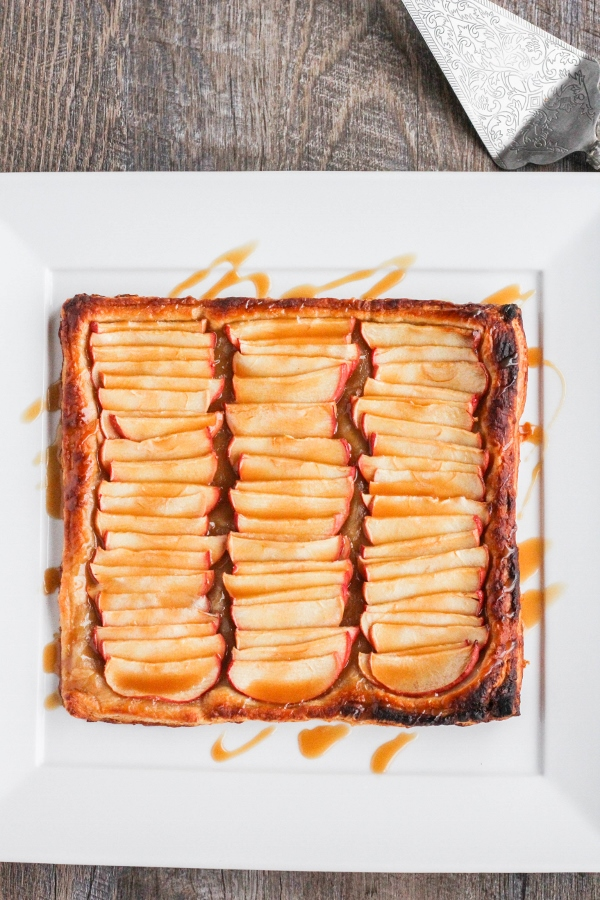 Celebrate fall and the upcoming holidays with this flaky and delicious Simple Apple Tart. Topped with a drizzle of caramel sauce, this is one dessert that everyone is sure to love!