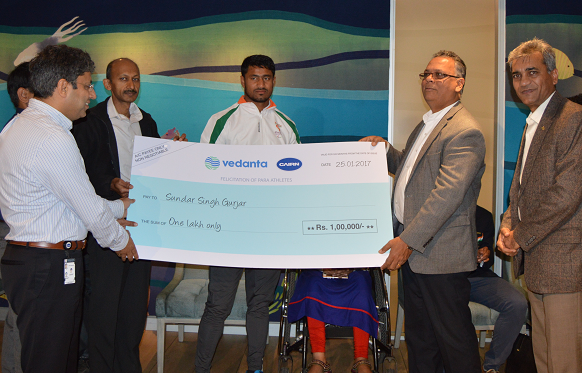 Senior Executive from Cairn presenting cheque to Sundar Singh Gurjar