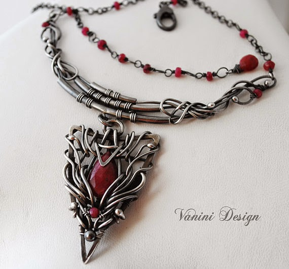 https://www.etsy.com/listing/185538430/afflatus-finesterling-silver-and-ruby?ref=shop_home_feat_4