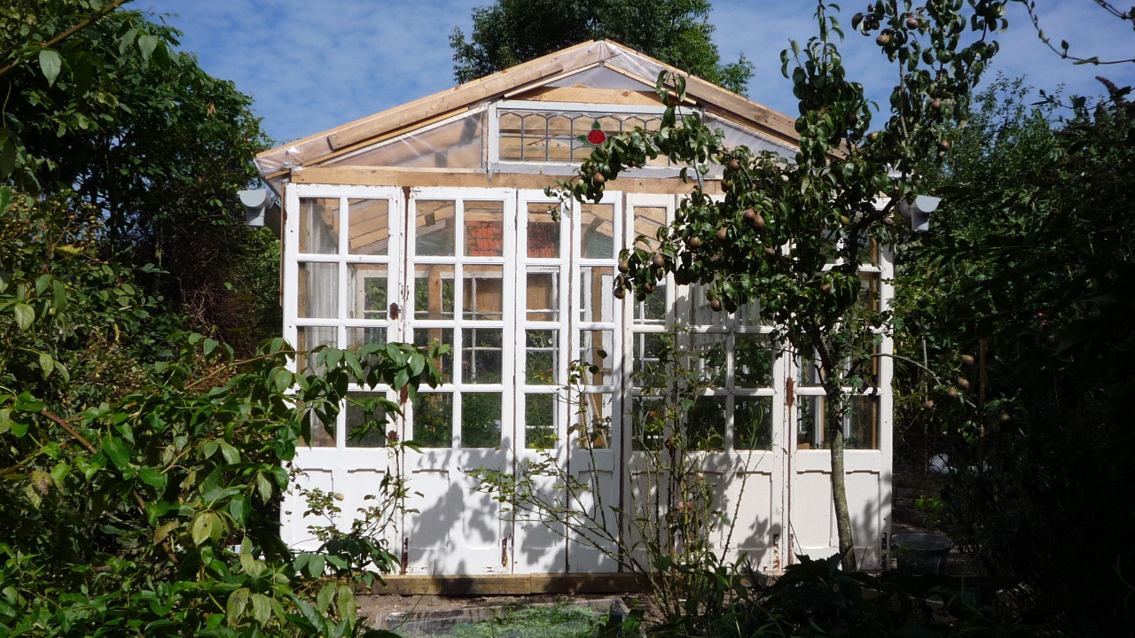 Recycled glass greenhouse from old windows