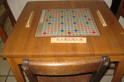 photo of little table with scrabble letters - forever young