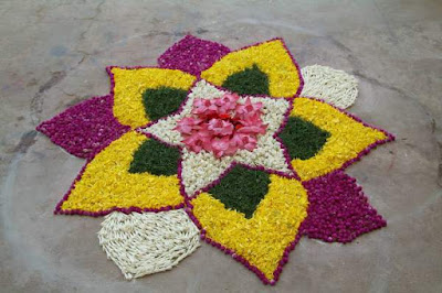 Rangoli Designs with Flowers and Having Traditional Themes