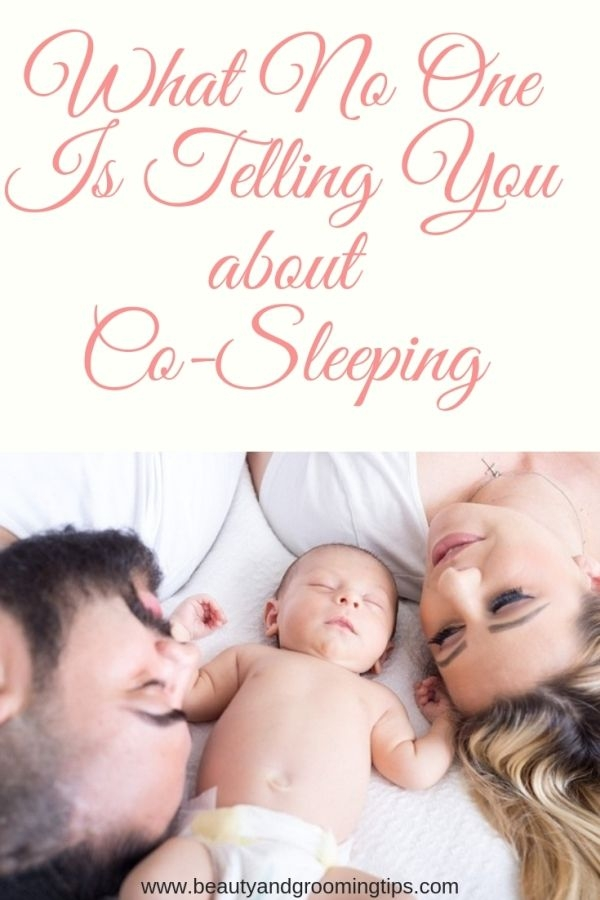baby peacefully sleeping between parents - all about co-sleeping