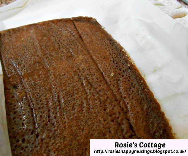 Super Yummy Chocolate Swiss Roll: Roll just a little of the baking paper back and using a knife very carefully make a slight indent across the sponge in order to begin to roll it.