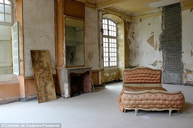 interior room of Chateau Gudanes with dusty rose and peely wallpaper