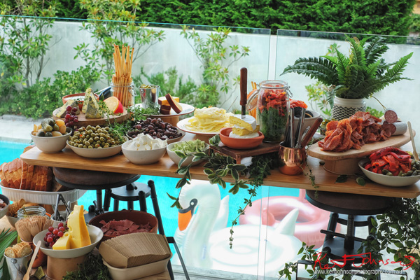 The grazing table and some pool toys - Havana Days pool party Launch Event - Photographed by Kent Johnson for Street Fashion Sydney