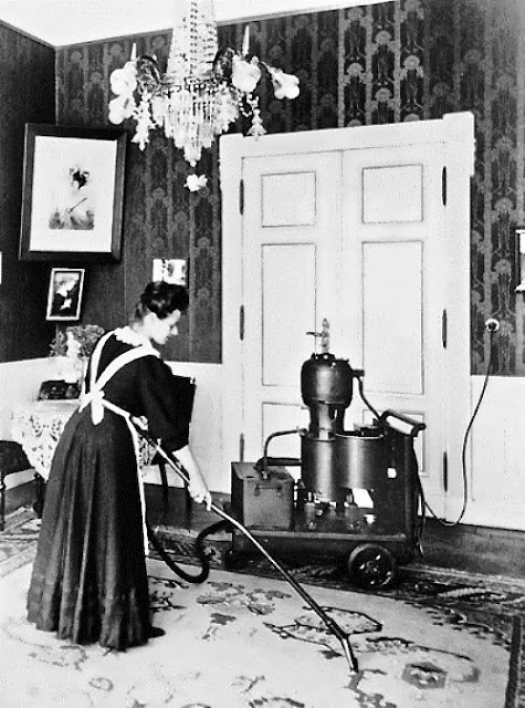 Vintage photo. Maid in uniform uses on of the earliest vacuum to clean a large parlor. c.1900s. Housekeeping A Word to Women by Mrs. C. E. Humphry, 1898. marchmatron.com