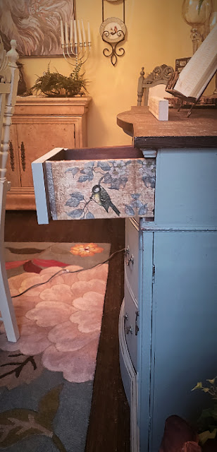 decoupage napkins on the side of a vintage buffet drawer