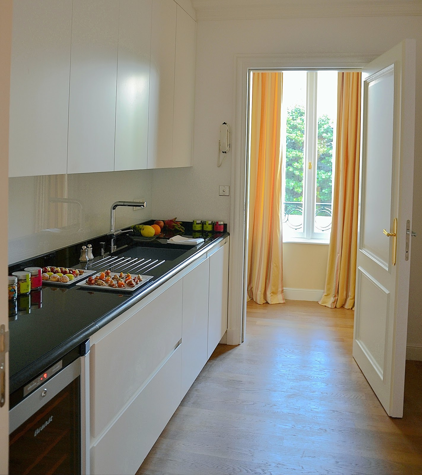 Inside Is Beautiful Paris Clean Line Kitchen With A Parquet Floor