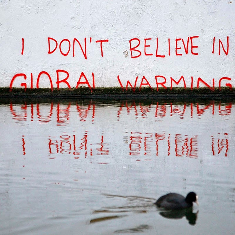 15 Of Banksy's Most Iconic Street Artworks - I Don't Believe In Global Warming, 2005