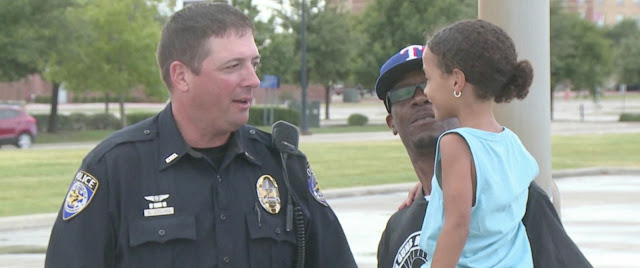 Photos show moment police officer calmed girl who freaked out after her dad was stop for routine traffic check.