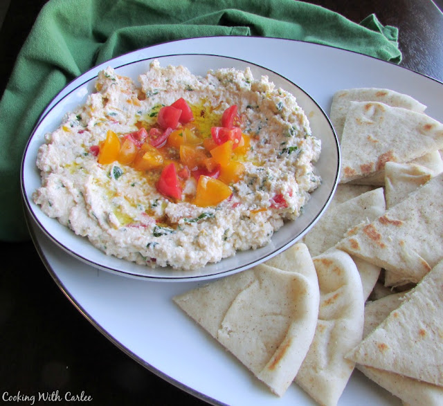 small bowl of feta spread with wedges of pita bread