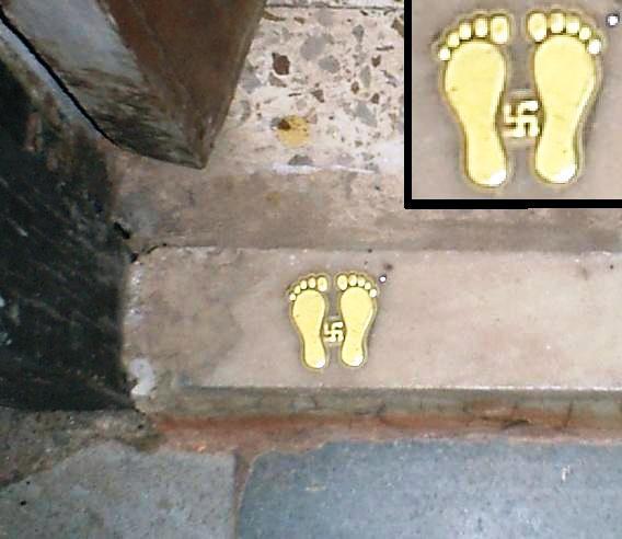 Swastika on the doorstep of an apartment in Maharashtra, India