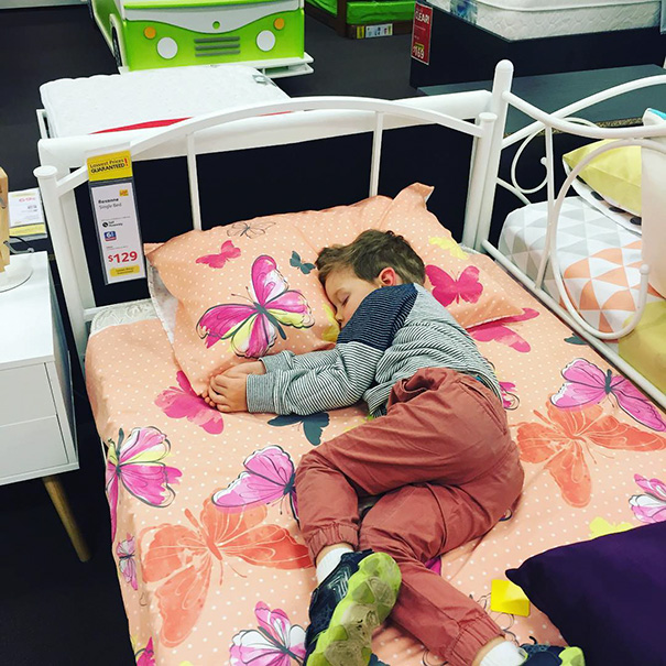 15+ Hilarious Pics That Prove Kids Can Sleep Anywhere - Napping In The Furniture Shop
