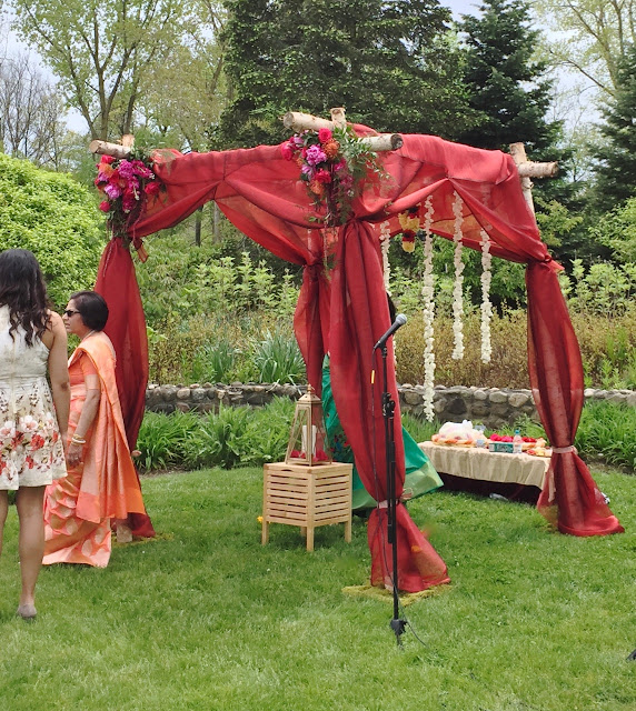 Mandap birch chuppah with deep gem tones floral corners and flower garlands for Ann Arbor wedding by Sweet Pea floral design