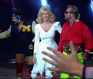 NWA Wrestlewar 1989 - Missy Hyatt leads Eddie Gilbert and Rick Steiner to the ring