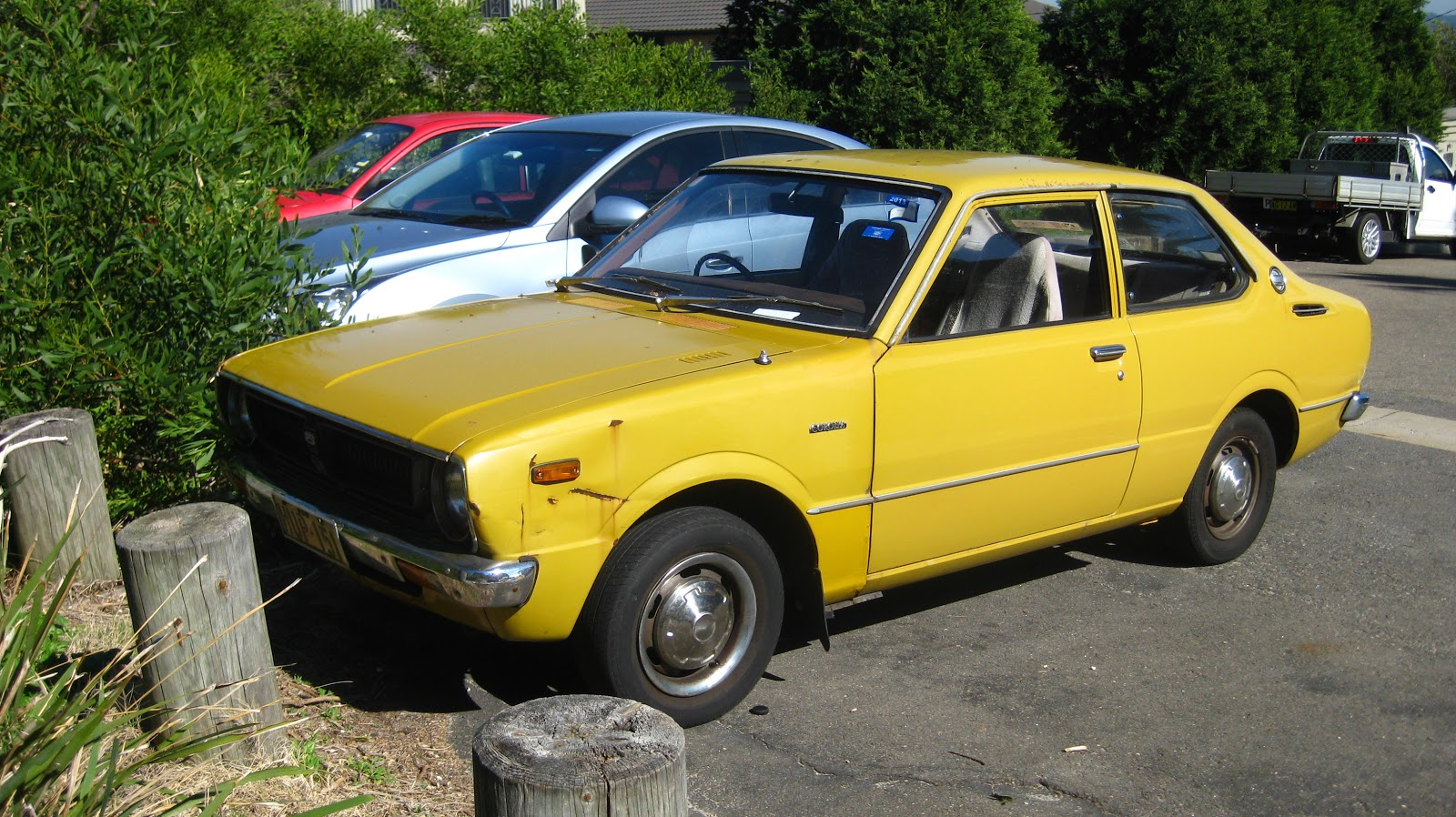 Image result for 1988 toyota corolla yellow four door