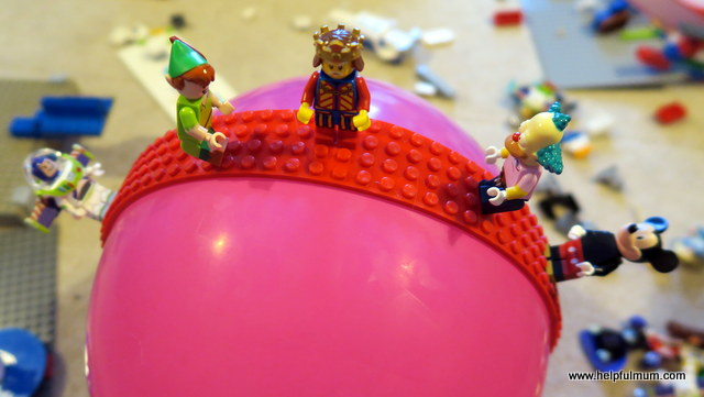 Mayka toy block tape on a balloon